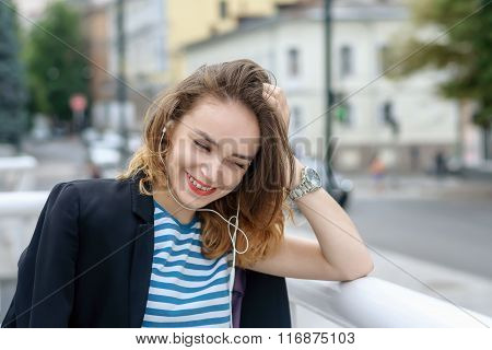 Girl Listening To Music On Headphones And Laughs