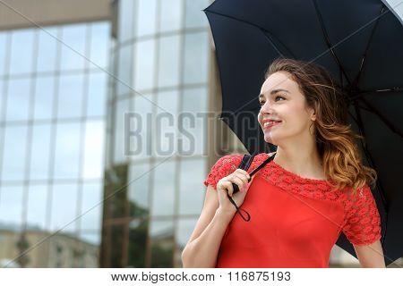 Woman Is Under An Umbrella