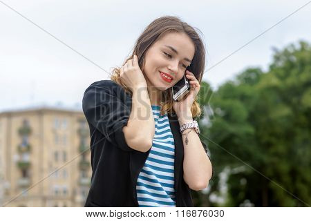 Girl Talking On Cell Phone And Smiling