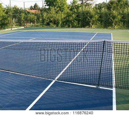 Tennis Court With Blue Ground.