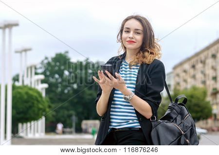 Tourist Communicates On A Cell Phone