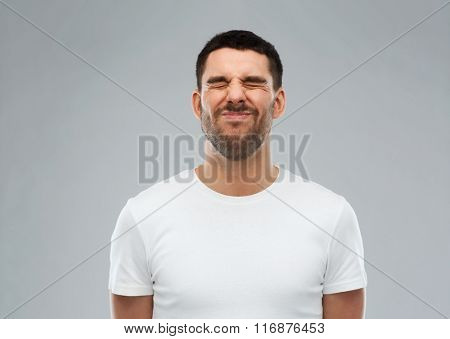 man wrying over gray background