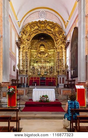 Obidos, Portugal - August, 2015: Sao Pedro church baroque altar showing gilded woodcarving decoration. Obidos is a medieval town inside walls, and very popular among tourists.