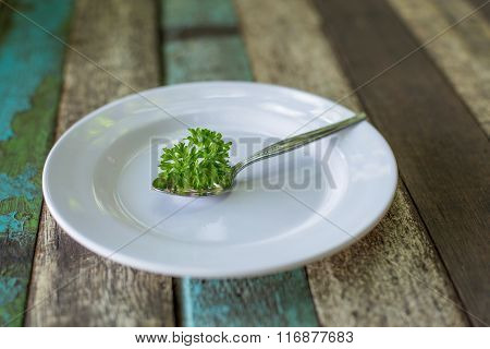 Plate With Spoon On Old Wooden Background