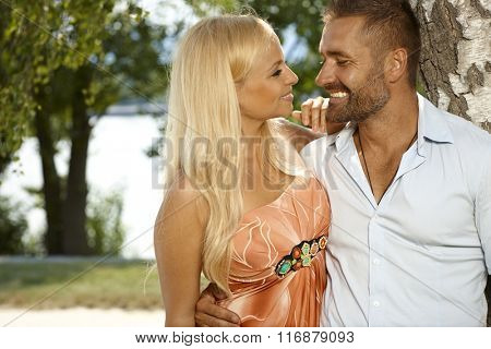 Portrait of happy smiling casual couple outdoor at riverside.