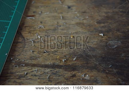 eraser shaving on wooden desk