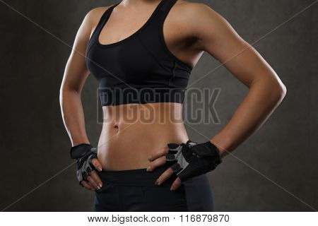 close up of young woman body in gym