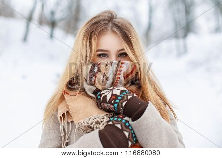 Portrait Of A Beautiful Girl In A Scarf And Gloves In Winter Park. Vintage Collection. Keep Warm
