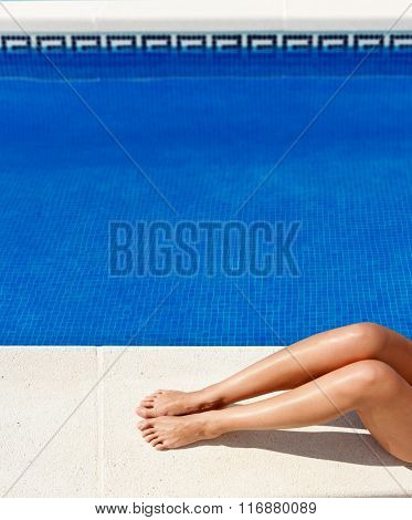 Woman legs by the poolside