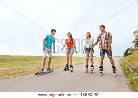 happy teenagers with longboards