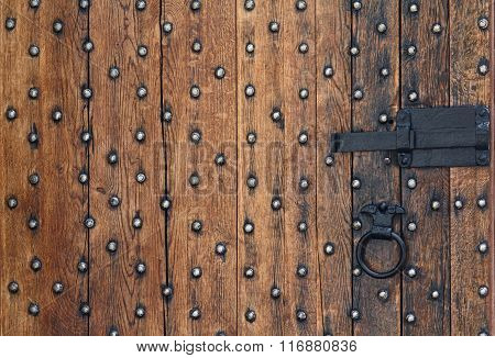 Old Wooden Door And A Metal Bolt. Backgrounds And Textures