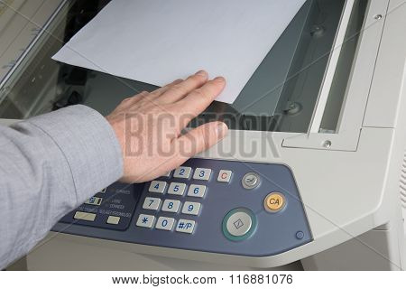 Man Takes Out  Documents From Printer Or Photocopier