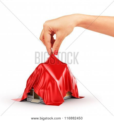 Concept Of House. Woman Hand Take Off Red Cloth From House.