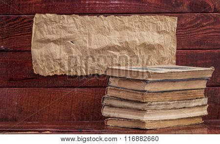 pile old books on a wooden table