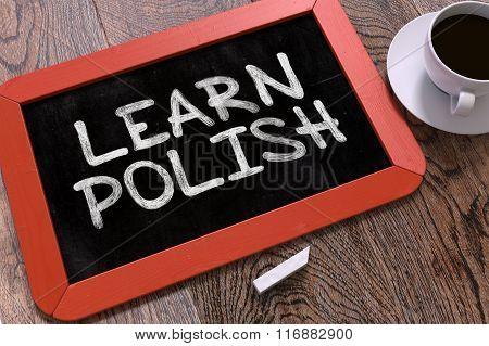 Hand Drawn Learn Polish Concept on Chalkboard.