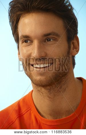Portrait of smiling handsome casual caucasian man. Smiling, perfect teeth, stubble.