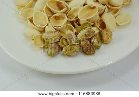 pistachio nut peel out on white dish