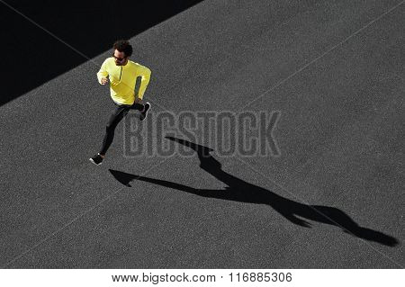 Running Man Sprinting For Success On Run. Top View Athlete Runner Training At Fast Speed At Asphalt.