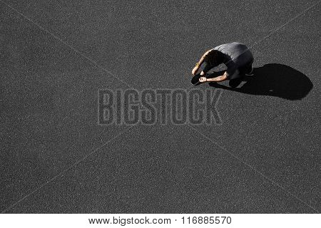 Top View Jogging Man Runner Tying Running Shoes Before Outdoor Workout. Runner Jogging Training And