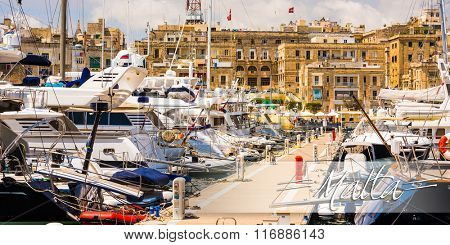 postcard with yachts in Valleta port on the background of the city in Malta
