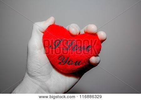 A Hand Holding A Heart That Says