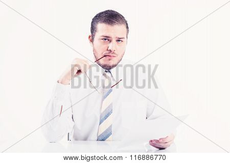 Young businessman reading document