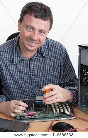 Computer Engineer Repairing Hardware In Bright Office