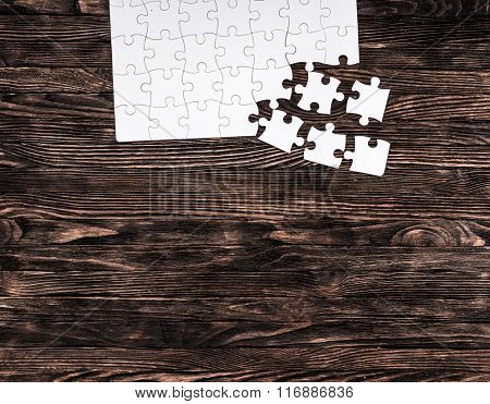 white uncompleted puzzle from one side and text space