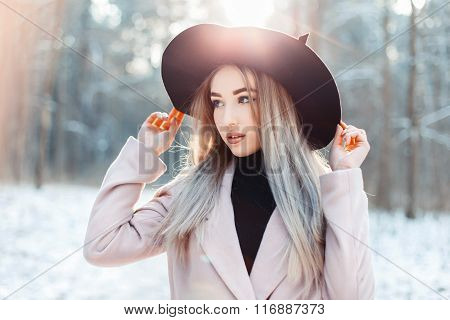 Stylish Beautiful Woman In Elegant Hat And Coat Walking In A Winter Park At Sunset