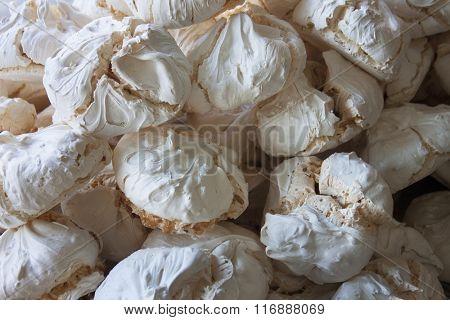 meringue cake as background.
