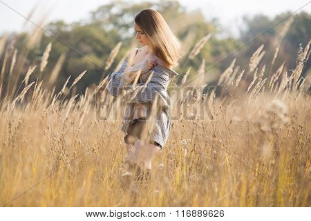 beautiful girl with red hair in a field