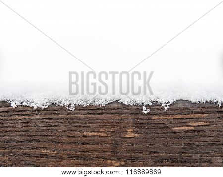 Painted wooden board or timber covered with snow