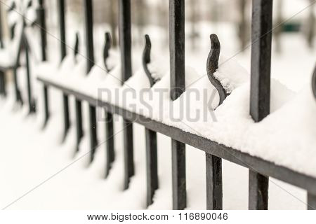 Strong Cast Iron Fence And Winter