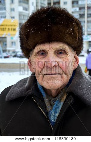 Proud Russian Old Man With Fur Hat In Winter
