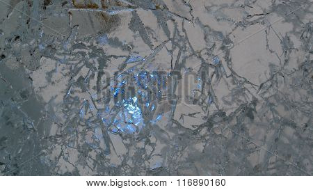 Frozen Blue Ice With Cracks