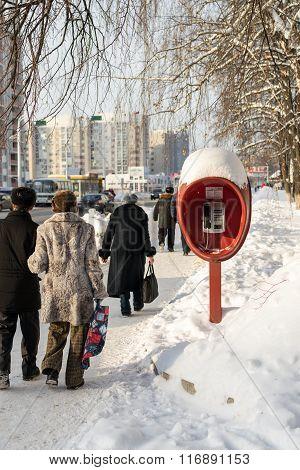 Pedestrians Soviet Phonebox In Russian Winter
