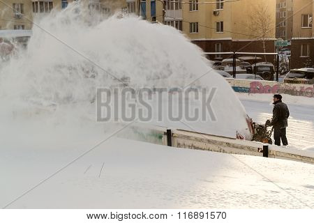 Clearing Snow Machine And Worker At Work