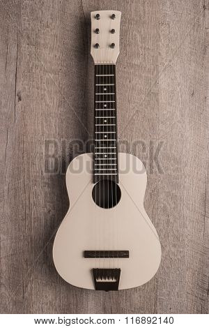 Guitar On Rustic Wooden Background