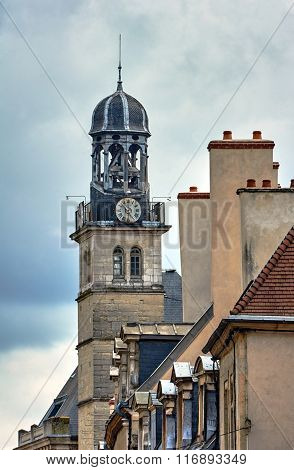 Townhouses and belfry with a clock