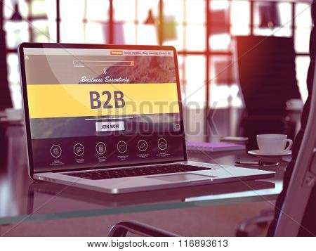B2B on Laptop in Modern Workplace Background.