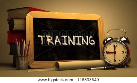 Handwritten Training on a Chalkboard.