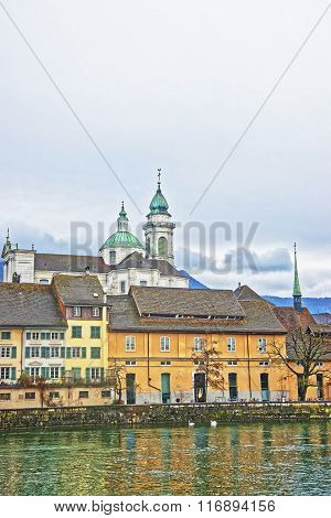 Waterfront and Saint Ursus Cathedral in Solothurn. Solothurn is the capital of Solothurn canton in Switzerland. It is located on the banks of Aare and on the foot of Weissenstein Jura mountains