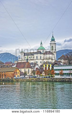Waterfront and St Ursus Cathedral in Solothurn. Solothurn is the capital of Solothurn canton in Switzerland. It is located on the banks of Aare and on the foot of Weissenstein Jura mountains
