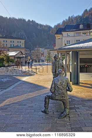BAD RAGAZ SWITZERLAND - JANUARY 5 2015: People bronze monument. Bad Ragaz is a city in the St. Gallen in Switzerland over the Graubunden Alps. The Spa and recreation is at the Tamina valley