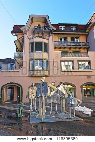 BAD RAGAZ SWITZERLAND - JANUARY 5 2015: People composition statue. Bad Ragaz is a city in the St. Gallen in Switzerland over the Graubunden Alps. The Spa and recreation village is at Tamina valley