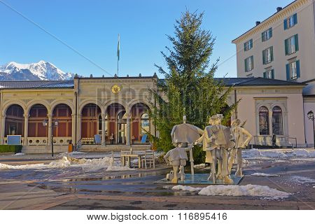 BAD RAGAZ SWITZERLAND - JANUARY 5 2015: Spa house with People monument and Mountains. Bad Ragaz is a city in St. Gallen in Switzerland over Graubunden Alps. Spa and recreation is at Tamina valley