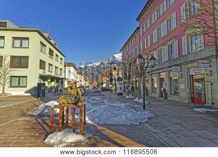 BAD RAGAZ SWITZERLAND - JANUARY 5 2015: Monument of Sitting Man and Mountain. Bad Ragaz is a city in the St. Gallen in Switzerland over Graubunden Alps. Spa and recreation is at the Tamina valley