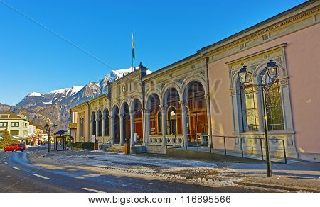 BAD RAGAZ SWITZERLAND - JANUARY 5 2015: Spa house with Cat statue and Mountains. Bad Ragaz is a city in St. Gallen in Switzerland over Graubunden Alps. Spa and recreation is at the Tamina valley