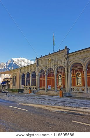 BAD RAGAZ SWITZERLAND - JANUARY 5 2015: Mountain and Spa house with Cat statue. Bad Ragaz is a city in St. Gallen in Switzerland over Graubunden Alps. Spa and recreation village is in Tamina valley