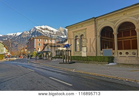 BAD RAGAZ SWITZERLAND - JANUARY 5 2015: Mountain and Spa house with Cat statue. Bad Ragaz is a city in St. Gallen in Switzerland Graubunden Alps. Spa and recreation is at the end of Tamina valley